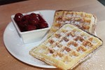 Belgian waffles with hot cherries
