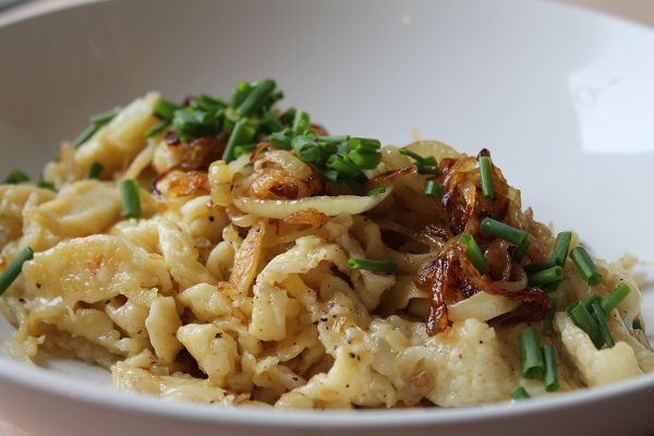 Cheese Spaetzle garnished with braised onions and chives